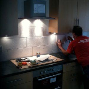 Modern Kitchen being tiled